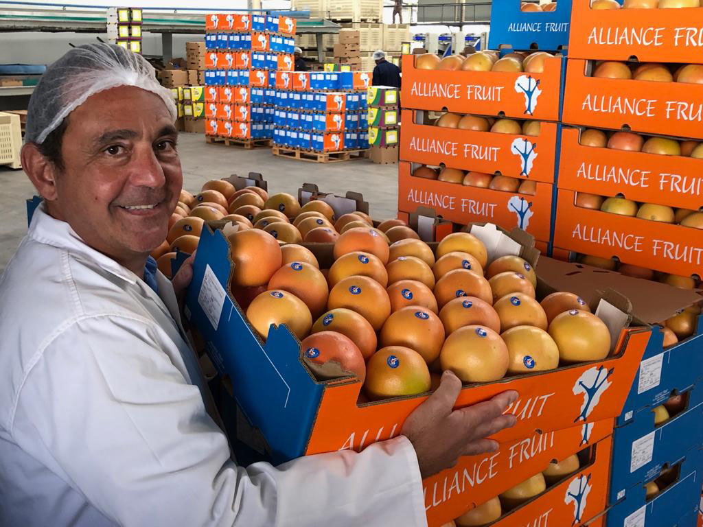 Bruno Edery holding a box of imported citrus - Beva Fruits International (BFI)